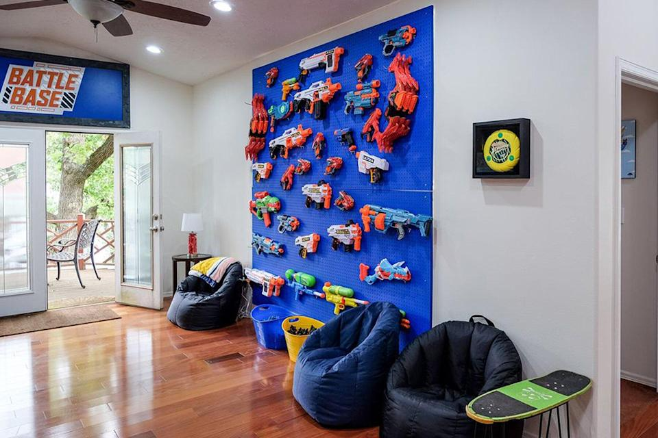 A wall of nerf guns at the Nerf House