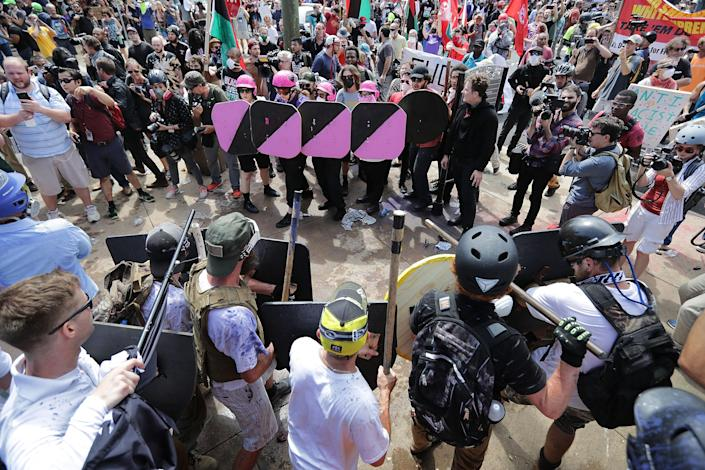 """<p>Battle lines form between white nationalists, neo-Nazis and members of the """"alt-right"""" and anti-fascist counter-protesters at the entrance to Lee Park during the """"Unite the Right"""" rally Aug. 12, 2017 in Charlottesville, Va. (Photo: Chip Somodevilla/Getty Images) </p>"""