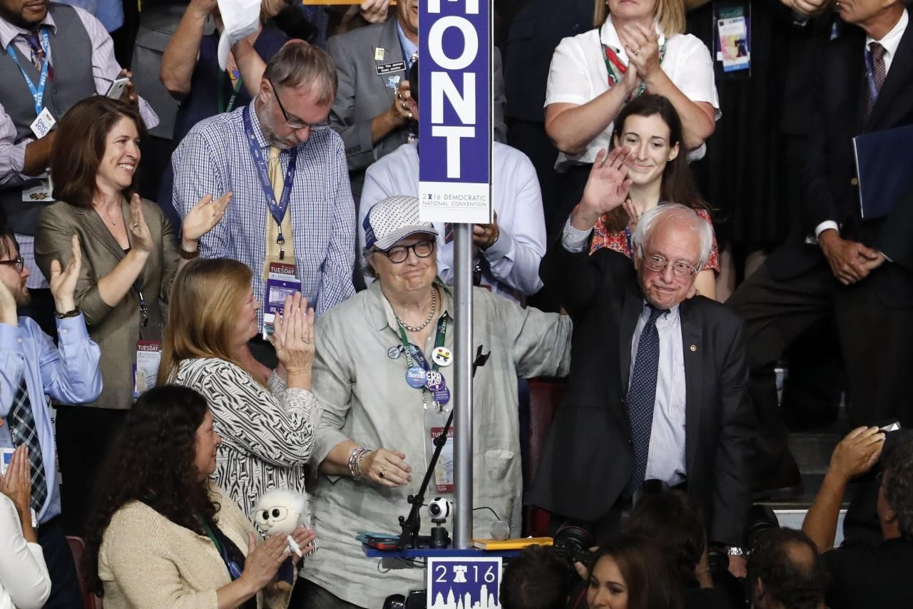 Standing with the Vermont delegation, Bernie Sanders waves after asking the convention to make Clinton the unanimous choice for president of the United States. (Photo: Mary Altaffer/AP)