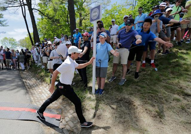 Rory McIlroy, friend to bugs, children and other tiny creatures. (AP)