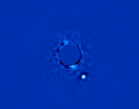 Gemini Planet Imager's first light image of Beta Pictoris b, a planet orbiting the star Beta Pictoris. The star, Beta Pictoris, is blocked in this image by a mask so its light doesn't interfere with the light of the planet.