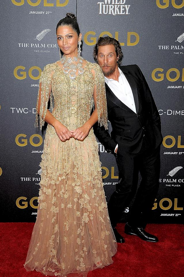 <p>Matthew McConaughey gets it. He's an attractive guy, but when wife Camila Alves is on the red carpet, as she was at his <i>Gold</i> premiere in NYC, it's about her and her dress. So what if she's not in the movie! (Photo: Chance Yeh/FilmMagic) </p>
