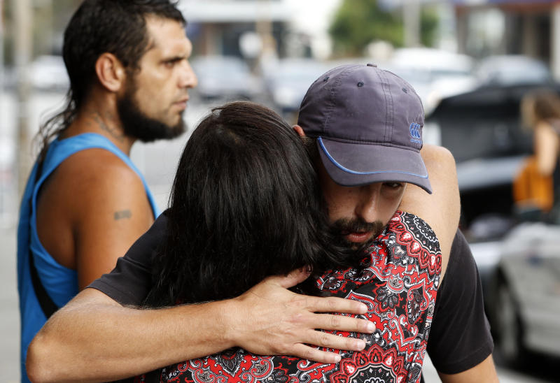 Family and friends of victim Ricky Slater-Dickson hug each other outside of court in March. Source: AAP