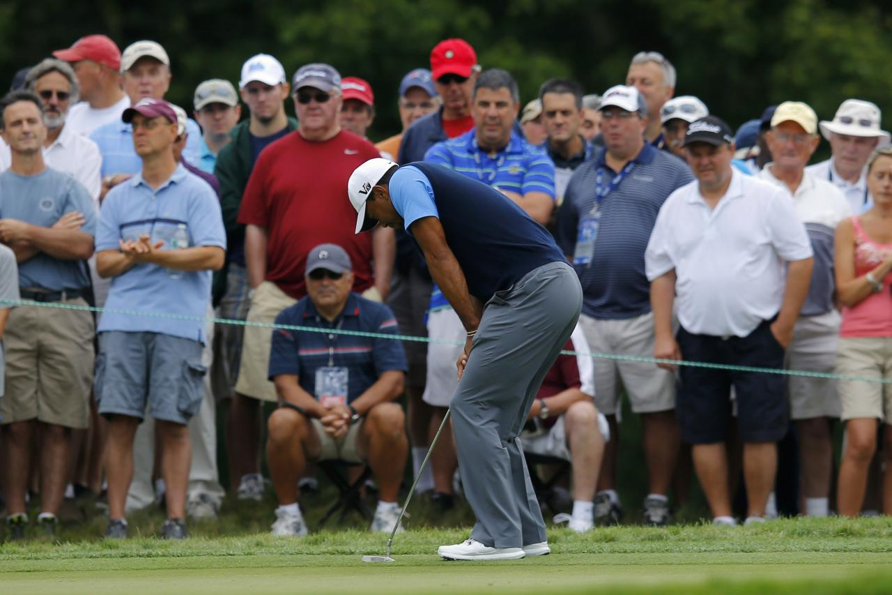 Tiger Woods of the U.S. reacts missing his birdie putt on the 13th hole during the first round of the Deutsche Bank Championship golf tournament in Norton, Massachusetts August 30, 2013. REUTERS/Brian Snyder (UNITED STATES - Tags: SPORT GOLF)