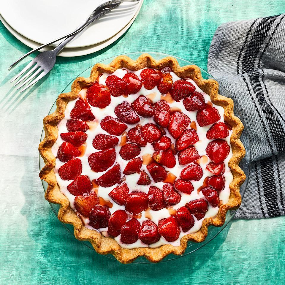 """<p>This simple strawberry tart shines with the natural sweetness of fresh strawberries. A lightly sweetened cream cheese filling holds the berries in place, while a light glaze of strawberry jam gives the tart an extra boost of strawberry flavor. <a href=""""https://www.eatingwell.com/recipe/7884894/strawberry-tart/"""" rel=""""nofollow noopener"""" target=""""_blank"""" data-ylk=""""slk:View recipe"""" class=""""link rapid-noclick-resp""""> View recipe </a></p>"""