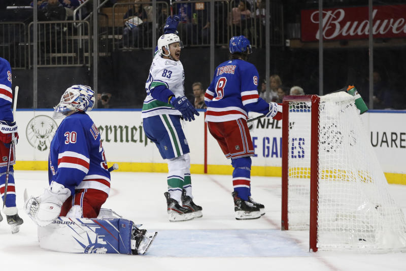 Vancouver Canucks center Jay Beagle (83) reacts after scoring a goal on New York Rangers goaltender Henrik Lundqvist (30) of Sweden in the first period of a NHL hockey game, Sunday, Oct. 20, 2019, in New York. New York Rangers defenseman Jacob Trouba (8) skates away, right. (AP Photo/Kathy Willens)