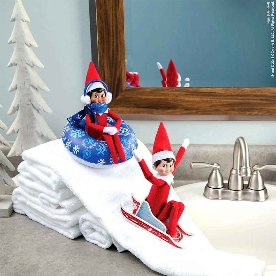 """<p>White washcloths make a handy stand-in for snowy slopes!</p><p><a class=""""link rapid-noclick-resp"""" href=""""https://shop.elfontheshelf.com/products/totally-tubular-snow-set"""" rel=""""nofollow noopener"""" target=""""_blank"""" data-ylk=""""slk:BUY SNOW TUBE SET"""">BUY SNOW TUBE SET</a></p>"""