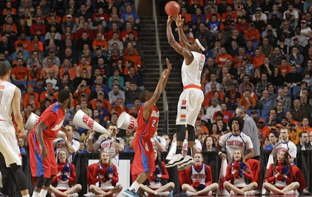 Syracuse's C.J. Fair (5) shoots over Dayton's Jordan Sibert (24) during the first half of a third-round game in the NCAA men's college basketball tournament in Buffalo, N.Y., Saturday, March 22, 2014. (AP Photo/Bill Wippert)