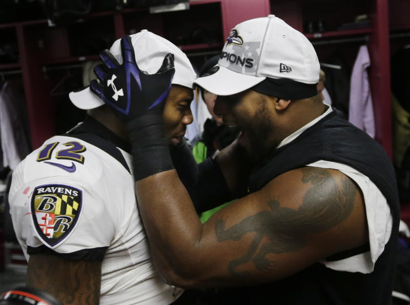 Baltimore Ravens inside linebacker Ray Lewis, right, and Jacoby Jones celebrate in the team's locker room after the NFL football AFC Championship football game against the New England Patriots in Foxborough, Mass., Sunday, Jan. 20, 2013. The Ravens defeated the Patriots, 28-13, to advance to Super Bowl XLVII. (AP Photo/Elise Amendola)