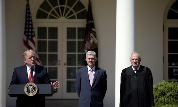 """<span class=""""element-image__caption"""">Anthony Kennedy with Donald Trump and Neil Gorsuch in April last year. Kennedy has been the critical 'swing vote' on the court for more than a decade.</span> <span class=""""element-image__credit"""">Photograph: Brendan Smialowski/AFP/Getty Images</span>"""