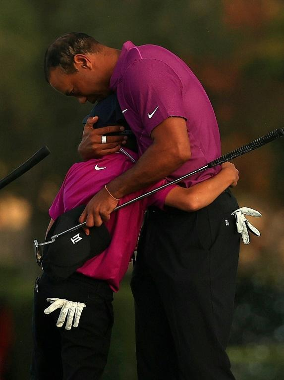 Tiger Woods and son Charlie share a hug after the first round of the PNC Championship family team tournament
