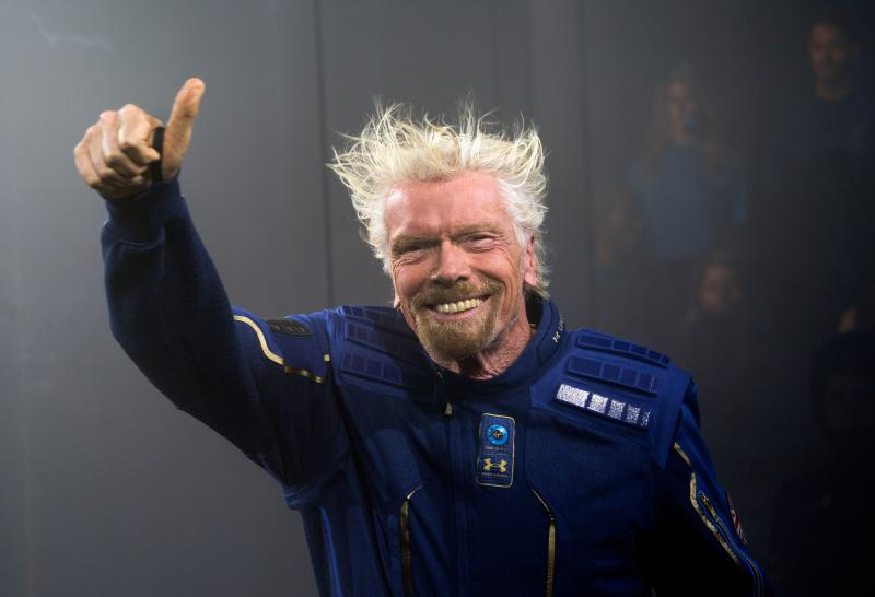 Virgin Galactic Founder Sir Richard Branson demonstrates a spacewear system, designed for Virgin Galactic astronauts, at an event October 16, 2019 in Yonkers, New York. - At the event Virgin Galactic and Under Armour unveiled the worlds first exclusive spacewear system for private astronauts. (Photo by Don Emmert / AFP) (Photo by DON EMMERT/AFP via Getty Images)