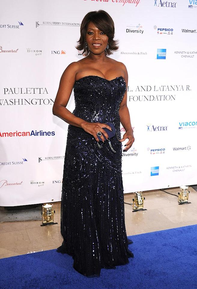 """Alfre Woodard dazzled at a recent Spelman College scholarship gala in a mesmerizing Alberto Makali strapless gown, which she perfectly paired with a Swarovski clutch, navy nails, and a classic cocktail ring. Bryan Bedder/<a href=""""http://www.gettyimages.com/"""" target=""""new"""">GettyImages.com</a> - October 4, 2010"""