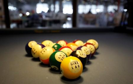 Nike's billiard balls are seen at a relax room of Maxport garment company in Hanoi,