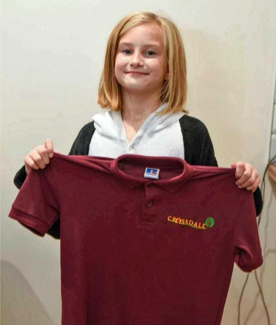 9-year-old Lily wears a onesie to school after becoming allergic to her uniform. (Photo: Caters)