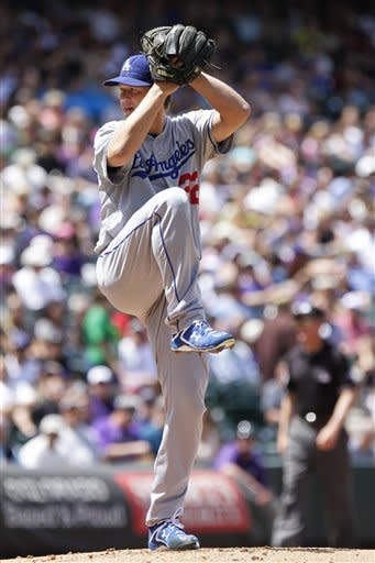 Los Angeles Dodgers starting pitcher Clayton Kershaw (22) delivers against the Colorado Rockies during the first inning of a baseball game, Wednesday, May 2, 2012, in Denver. (AP Photo/Barry Gutierrez)