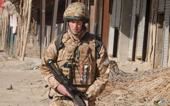 Prince Harry on patrol through the deserted town of Garmisir, where he was posted in Helmand province - PA