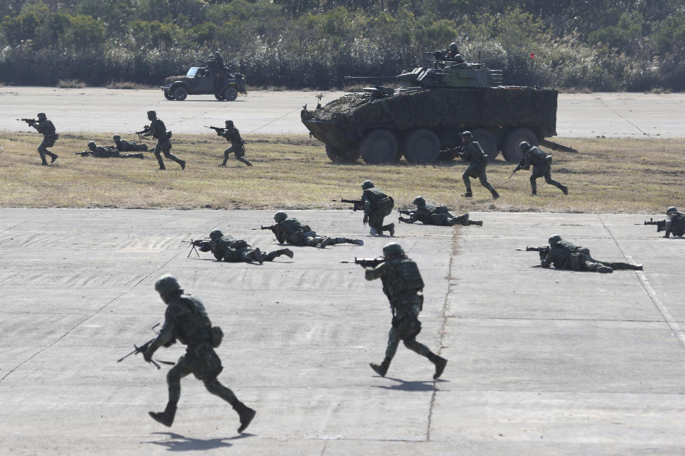 Soldiers take part in a military exercise in Hsinchu County, northern Taiwan, Tuesday, Jan. 19, 2021. Taiwanese troops using tanks, mortars and small arms staged a drill Tuesday aimed at repelling an attack from China, which has increased its threats to reclaim the island and its own displays of military might. (AP Photo/Chiang Ying-ying)