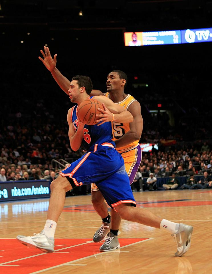 NEW YORK, NY - FEBRUARY 11: Landry Fields #6 of the New York Knicks drives against Ron Artest #15 of the Los Angeles Lakers at Madison Square Garden on February 11, 2011 in New York City. NOTE TO USER: User expressly acknowledges and agrees that, by downloading and/or using this Photograph, User is consenting to the terms and conditions of the Getty Images License Agreement.  (Photo by Chris Trotman/Getty Images)