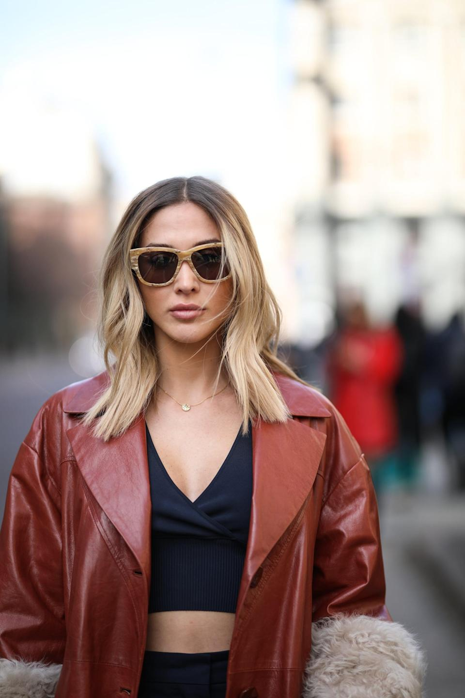 """<p>The clavicut is an appellation for where the hair hits and is the best of both worlds: short enough to pass as a long bob but long enough to wear in a ponytail. """"The <a href=""""https://www.popsugar.com/beauty/clavicut-haircut-ideas-47274352"""" class=""""link rapid-noclick-resp"""" rel=""""nofollow noopener"""" target=""""_blank"""" data-ylk=""""slk:clavicut is a collarbone-grazing style"""">clavicut is a collarbone-grazing style</a> that [looks good on] all hair types and face shapes,"""" said Tricomi. """"This style features back strands resting on the nape of your neck with the face-framing strands dipping an extra inch or two until they kiss your collarbone - an edgy yet sophisticated hairstyle, all at the same time.""""</p>"""