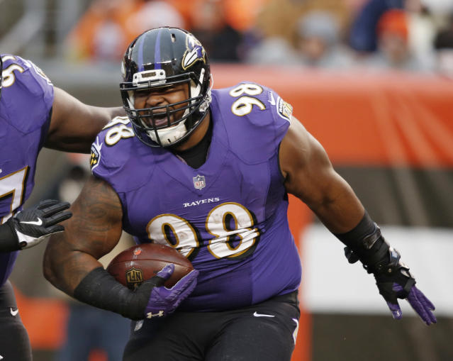 FILE - In this Dec. 17, 2017, file photo, Baltimore Ravens' Brandon Williams (98) celebrates after scoring on a 1-yard fumble recovery during the second half of an NFL football game against the Cleveland Browns, in Cleveland. Having overcome a malady that wont show up on any injury report, Ravens defensive tackle Brandon Williams is ready to resume his lucrative NFL career. Williams has an eye disease called keratoconus, a degenerative disorder which warps the corneas and can potentially cause blindness if left untreated. (AP Photo/Ron Schwane, File)