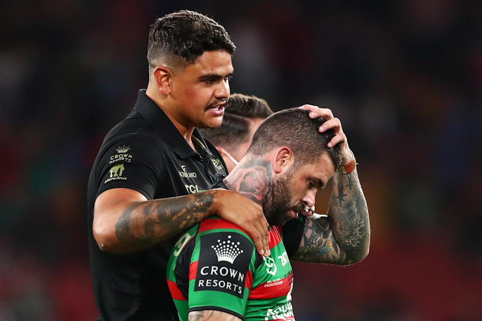 Adam Reynolds (pictured right0 is comforted by suspended team mate Latrell Mitchell (pictured left) as he looks dejected after defeat in the 2021 NRL Grand Final.
