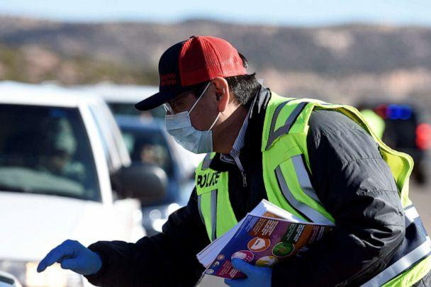 PHOTO: Navajo Nation President Jonathan Nez distributes educational material to drivers on how to prevent the spread of the novel coronavirus at a checkpoint in Window Rock, Arizona, on March 24, 2020. (Donovan Quintero/Reuters)