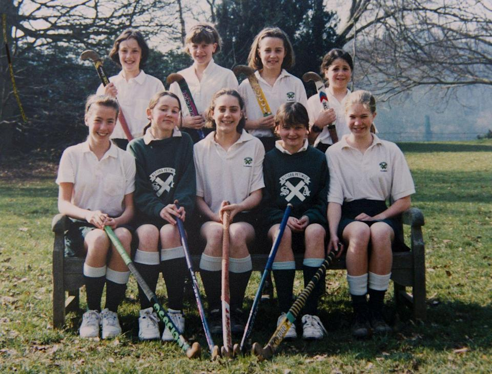 <p>Posing with her hockey teammates at St. Andrew's School in Pangbourne, Berkshire, the school she attended from 1986 to 1995.</p>