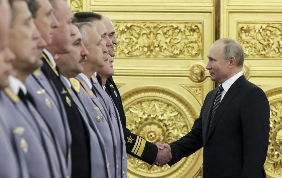 Russian President Vladimir Putin greets senior military officers during a meeting in Moscow, Russia, Wednesday, Nov. 6, 2019. Putin said Russia's new weapons have no foreign equivalents but he insists the country will not use them to threaten anyone. (Mikhail Klimentyev, Sputnik, Kremlin Pool Photo via AP)