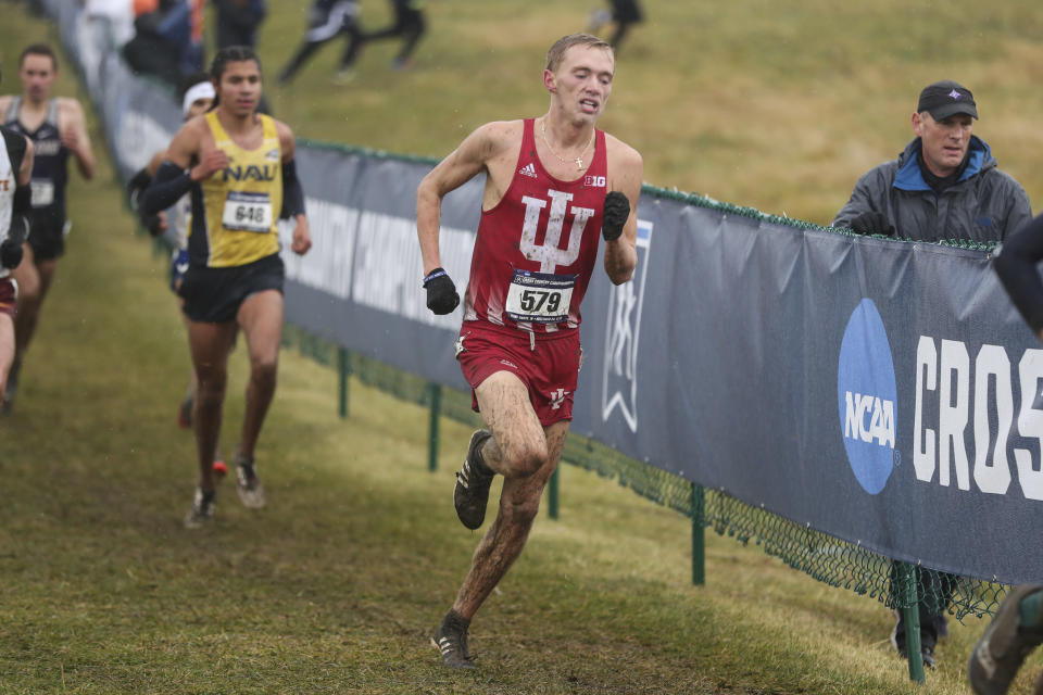 """In this photo provided by Indiana Athletics, Indiana's Ben Veatch (579) competes at the NCAA Cross Country championships on Nov. 23, 2019, in Terre Haute, Ind. The impact of moving traditional fall sports to later in the calendar due to COVID-19 includes some consequences unrelated to the pandemic itself. That has been evident this week as Big Ten runners have prepared for Saturday's cross country championships at Shelbyville, Indiana, while snow has blanketed much of the Midwest. """"We pride ourselves in running through pretty much everything,"""" Indiana fifth-year senior runner Ben Veatch said. """"It's going to hurt, regardless.""""(Andrew Mascharka/Indiana Athletics via AP)"""