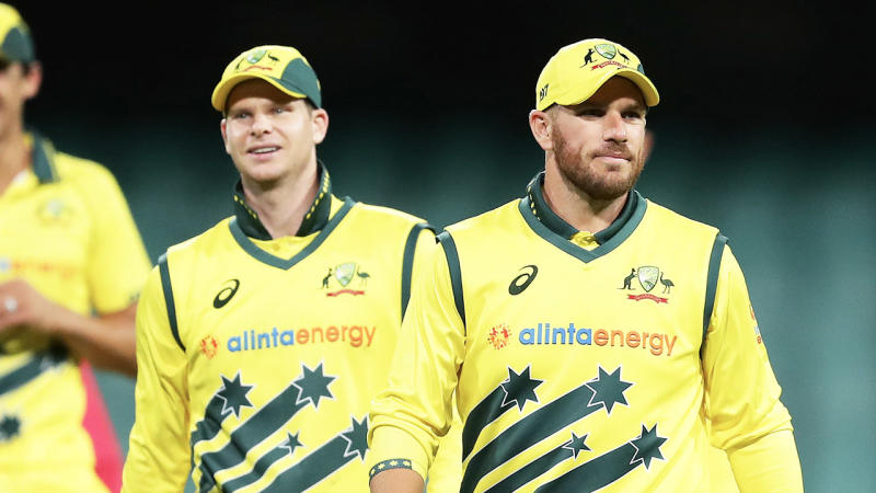 Steve Smith (pictured left) and Aaron Finch (pictured right) walk off the field.