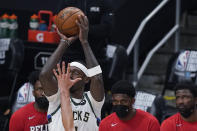 Milwaukee Bucks' Bobby Portis (9) scores against the Atlanta Hawks during the first half of Game 4 of the NBA basketball Eastern Conference finals Tuesday, June 29, 2021, in Atlanta. (AP Photo/Brynn Anderson)