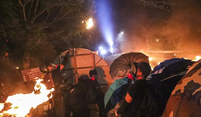 The level of violence in clashes between protesters and police is rising. Photo: Felix Wong