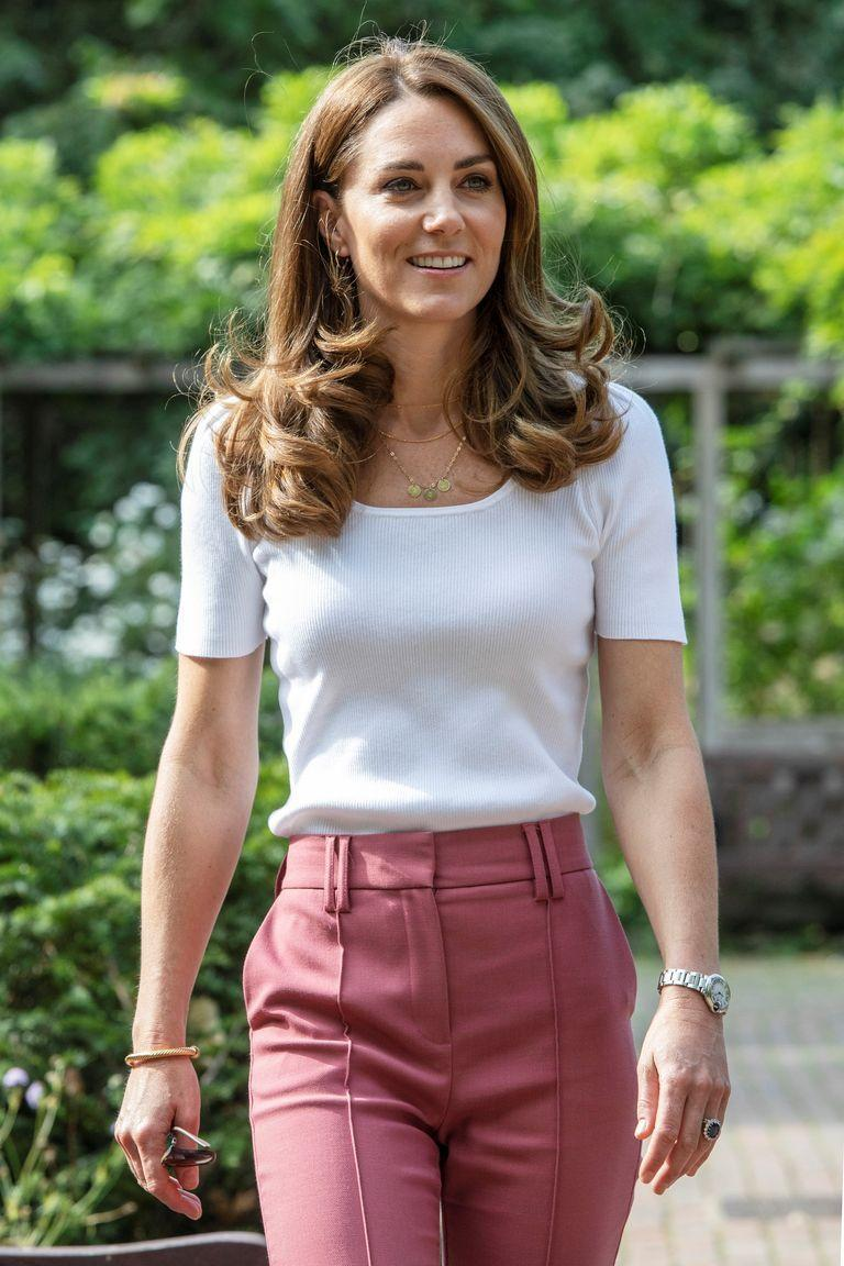 "<p>This isn't the first time Kate's repurposed the high street buy, wearing the <a href=""https://www.cosmopolitan.com/uk/fashion/celebrity/a34120183/kate-middleton-mands-trousers/"" rel=""nofollow noopener"" target=""_blank"" data-ylk=""slk:suit trousers"" class=""link rapid-noclick-resp"">suit trousers</a> in September for a visit to Battersea Park.</p>"