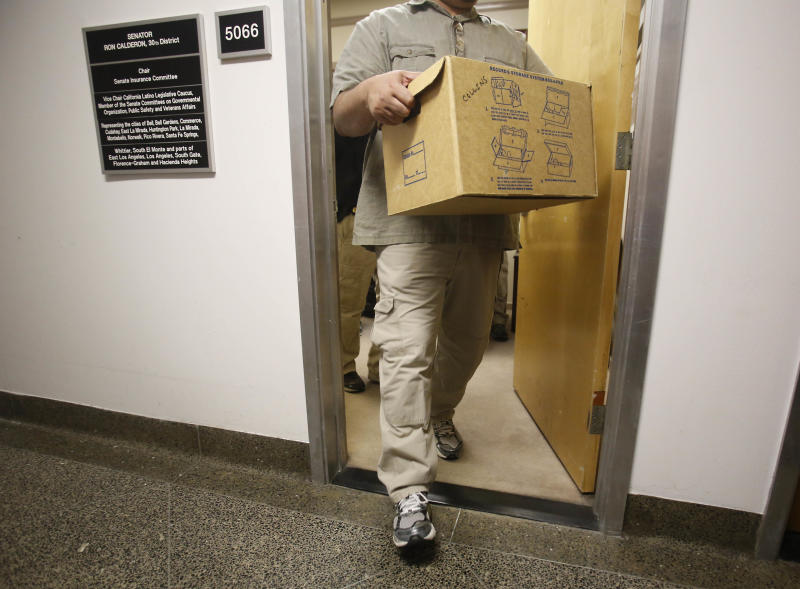 An FBI agent carries out a box as he leaves the Capitol office of State Sen. Ron Calderon, D-Montebello, in Sacramento, Calif., Tuesday, June 4, 2013. Search warrants were served about at Calderon's office and the office of the Legislature's Latino caucus, around 3 p.m., but would not disclose the reason for the investigation. Calderon was not present during the search.(AP Photo/Rich Pedroncelli)