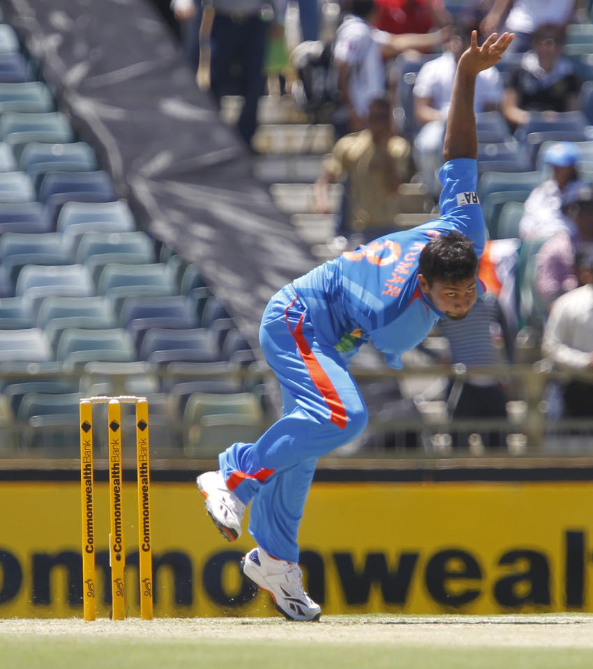 India's Praveen Kumar bowls against Sri Lanka during their one day international cricket match at the WACA in Perth, Australia, Wednesday, Feb. 8, 2012. (AP Photo/Theron Kirkman)