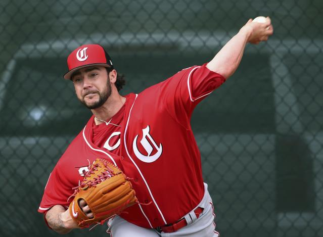 Cincinnati Reds pitcher Brandon Finnegan throws a pitch during workouts at the Reds spring training baseball facility, Wednesday, Feb. 13, 2019, in Goodyear, Ariz. (AP Photo/Ross D. Franklin)