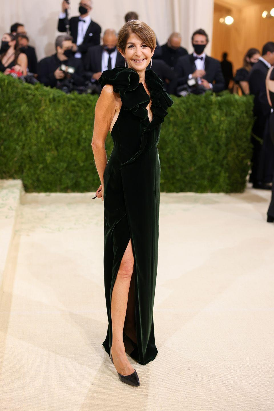<p>Nancy Chilton looked elegant as ever in a dark green velvet gown with a knee-high slit and statement puff straps. </p>