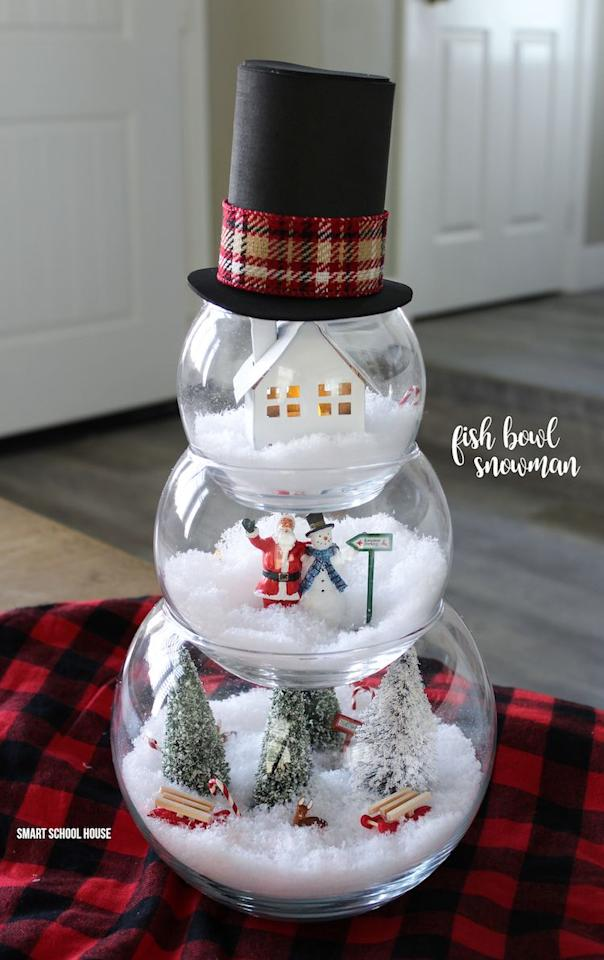 """<p>We love this unique spin on a winter terrarium. Feel free to get creative with the different scenes you choose.</p><p><strong>Get the tutorial at <a href=""""https://www.smartschoolhouse.com/diy-crafts/fish-bowl-snowman"""" target=""""_blank"""">Smart School House</a>.</strong></p><p><strong><a class=""""body-btn-link"""" href=""""https://www.amazon.com/Ounces-Clear-Bowls-Heavy-Plastic/dp/B07C5W96K8/?tag=syn-yahoo-20&ascsubtag=%5Bartid%7C10050.g.22825300%5Bsrc%7Cyahoo-us"""" target=""""_blank"""">SHOP FISH BOWLS</a><br></strong></p>"""