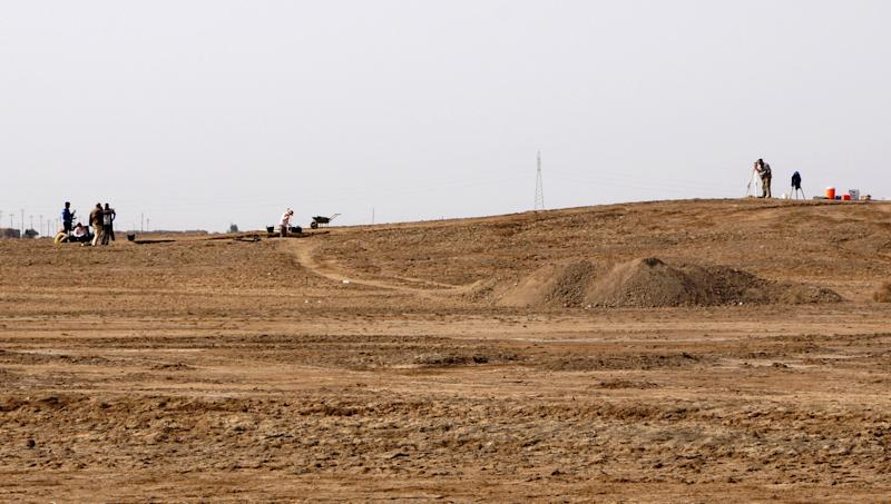 This photo taken on March 31, 2013 provided by Manchester University archaeologist Stuart Campbell shows excavation in progress at Tell Khaiber, Iraq. A British archaeologist says he and his colleagues have unearthed a huge, rare complex near the ancient city of Ur in southern Iraq, home of the biblical Abraham. Stuart Campbell of Manchester University's Archaeology Department says it goes back about 4,000 years, around the time Abraham would have lived there. It's believed to be an administrative center for Ur. (AP Photo/Stuart Campbell)