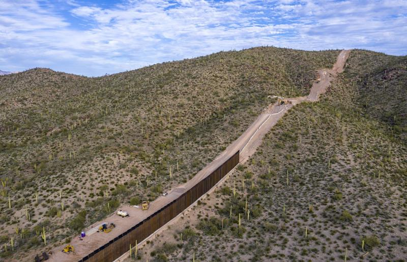 Border fence construction is underway in Arizona, blasting through sites like Monument Hill.