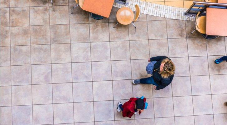 an overhead image of two people walking on a street