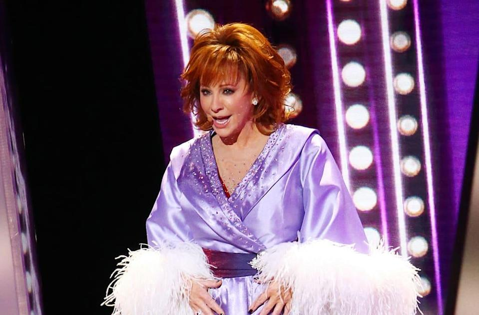 Reba McEntire tears off one dress after another during 'Fancy' performance at CMAs
