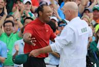 Tiger Woods (L) of the United States celebrates with caddie Joe LaCava (R) on the 18th green after winning during the final round of the Masters at Augusta National Golf Club on April 14, 2019 in Augusta, Georgia. (Photo by David Cannon/Getty Images)