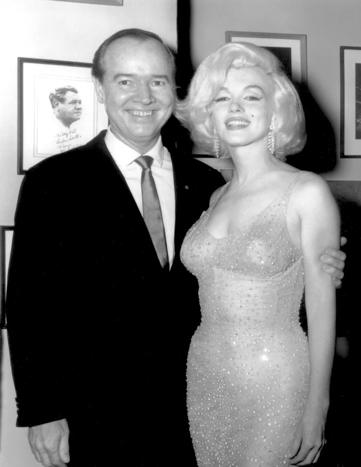 "In this May 19, 1962 publicity photo provided by Running Press, actress Marilyn Monroe, right, and celebrity promoter Earl Blackwell pose for a photo at the party following the birthday gala for President John F. Kennedy, where she sang ""Happy Birthday,"" in New York. (AP Photo/Courtesy Running Press)"