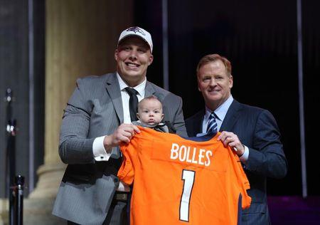Apr 27, 2017; Philadelphia, PA, USA; Garett Bolles (Utah) holds his son Kingston Bolles as he poses with NFL commissioner Roger Goodell as he is selected as the number 20 overall pick to the Denver Broncos in the first round the 2017 NFL Draft at the Philadelphia Museum of Art.  Bill Streicher-USA TODAY Sports