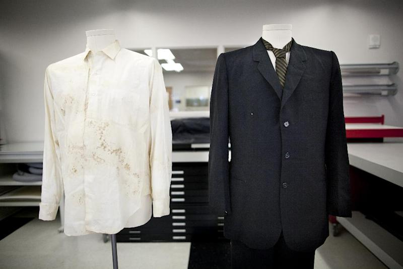 The white cotton shirt and black suit worn by Texas Gov. John Connally on the day gunfire wounded him and killed President John F. Kennedy in Dallas, Texas on Nov. 22, 1963, is pictured at the Texas State Library and Archives Commission in Austin, Texas on Tuesday, Oct. 15, 2013. Texas state archivists are preparing the suit and shirt worn by Connally as the centerpiece for an exhibit to mark next month's 50th anniversary of Kennedy's assassination. It will be the first public display of the clothing since 1964. (AP Photo/Tamir Kalifa)