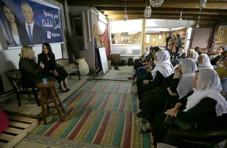 Retired Israeli army general Orna Barbivay (L) and Gadeer Kamal Mreeh speak at a conference in the northern Israeli Druze village of Daliyat al-Karmel on August 29, 2019 (AFP Photo/JALAA MAREY)