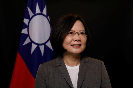 Taiwan President Tsai Ing-wen poses for photographs during an interview with Reuters at the Presidential Office in Taipei. REUTERS/Tyrone Siu