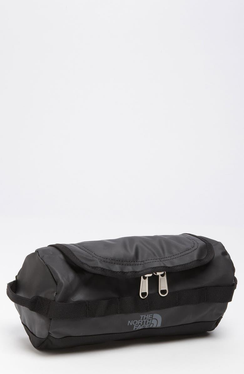 """<h2>The North Face Base Camp Travel Kit</h2><br><strong>Under $50</strong><br>He is so long overdue for an upgrade from that tattered Dopp kit he's been using since your childhood. This high-tech North Face toiletry bag boasts a sturdy construction and convenient bells and whistles that will get him psyched to travel again.<br><br><em>Shop The North Face at <strong><a href=""""https://www.nordstrom.com/brands/the-north-face--720"""" rel=""""nofollow noopener"""" target=""""_blank"""" data-ylk=""""slk:Nordstrom"""" class=""""link rapid-noclick-resp"""">Nordstrom</a></strong></em><br><br><strong>The North Face</strong> Base Camp Travel Kit, $, available at <a href=""""https://go.skimresources.com/?id=30283X879131&url=https%3A%2F%2Fwww.nordstrom.com%2Fs%2Fthe-north-face-base-camp-travel-kit%2F3324444%3F%26color%3Dtnf%2520black"""" rel=""""nofollow noopener"""" target=""""_blank"""" data-ylk=""""slk:Nordstrom"""" class=""""link rapid-noclick-resp"""">Nordstrom</a>"""
